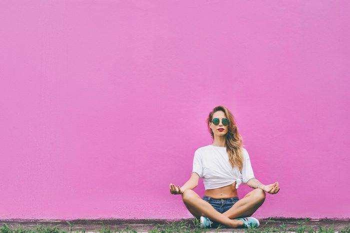 woman meditate wall