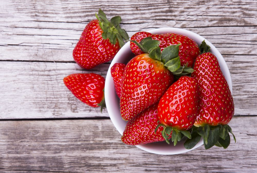 Fresh strawberries on old wooden background
