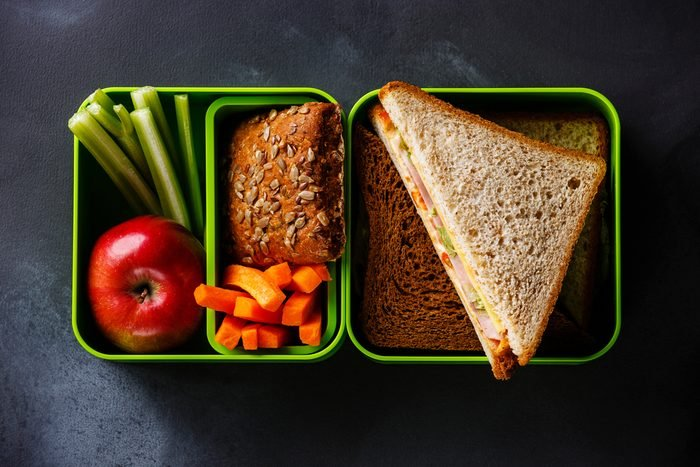 Take out food Lunch box with Sandwiches and vegetables on blackboard background