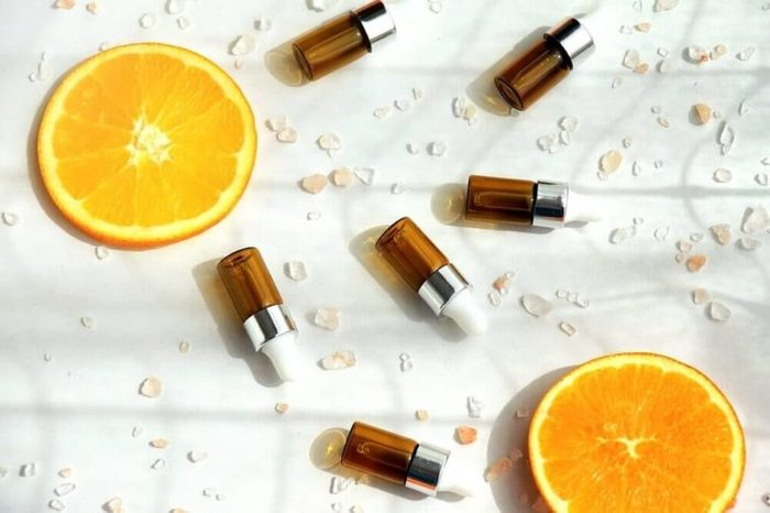 Brown bottles with fresh orange slices