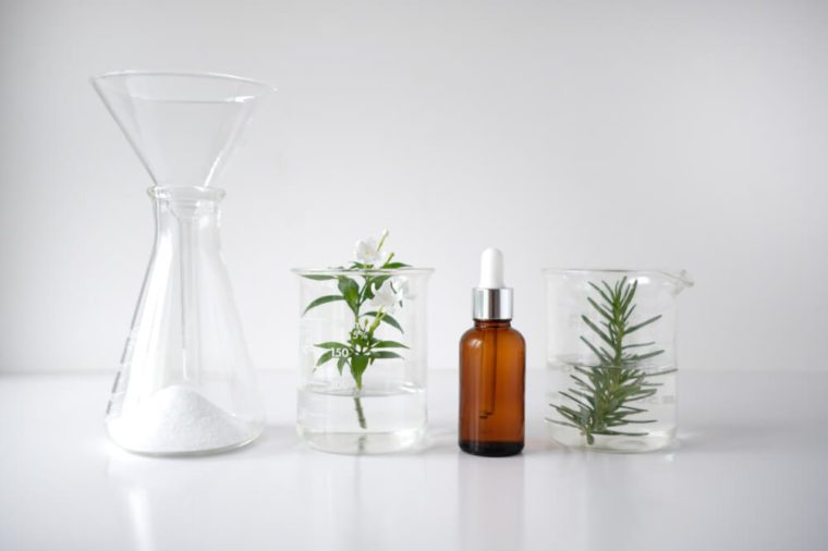 amber spray bottle and jars with herbs