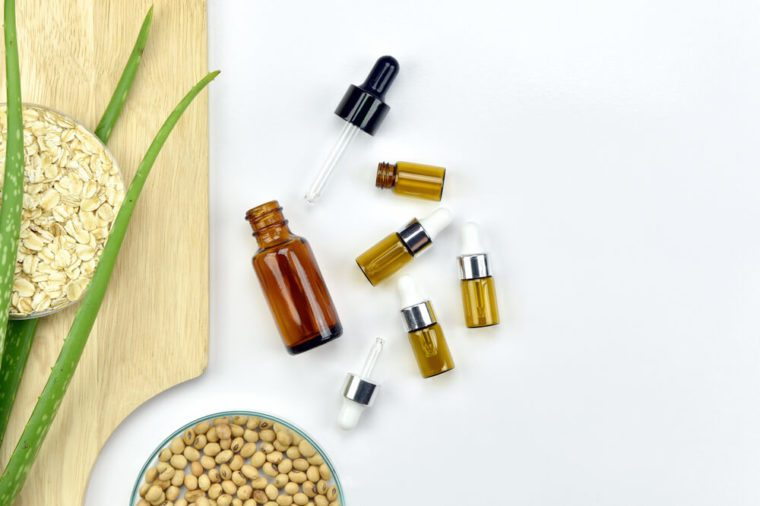 Aloe vera plant, essential oil in bottle with dropper