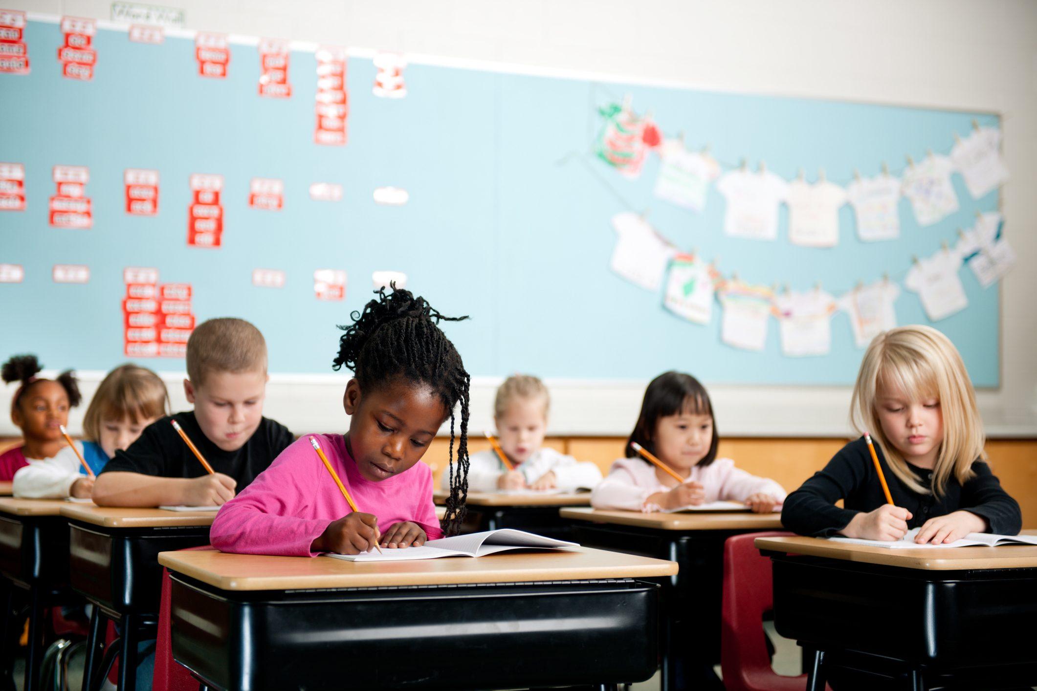 children in school working at desks