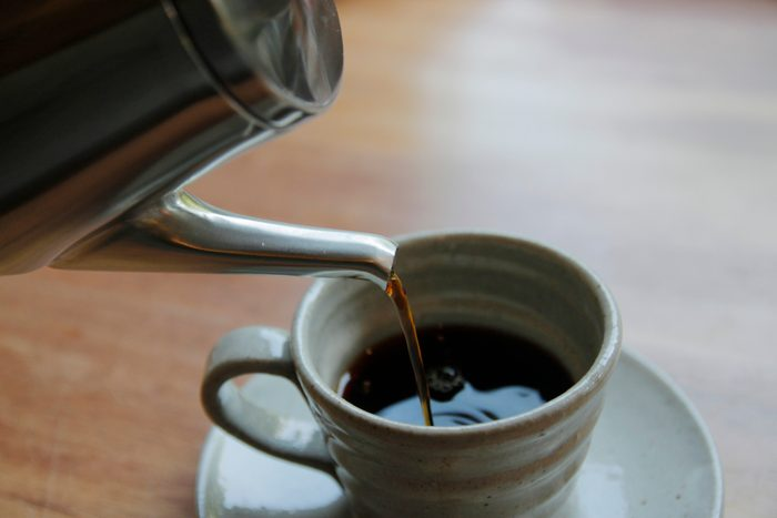 close up of coffee being poured into cup