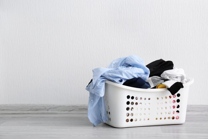 laundry bin filled with clothes