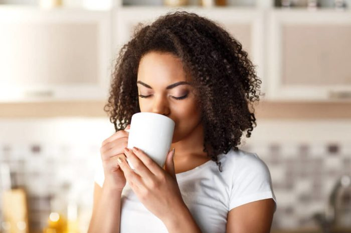 Woman sipping out of a mug