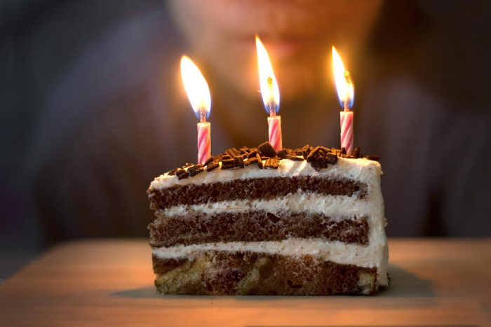 Blow out candles on birthday Cake