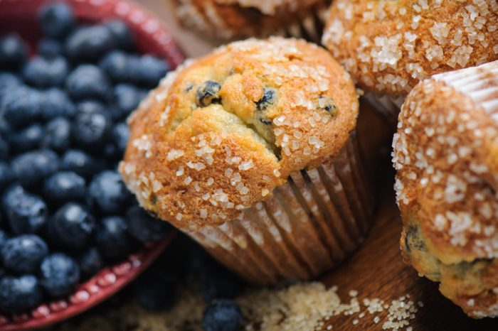 Blueberry Muffins next to a bowl of blueberries