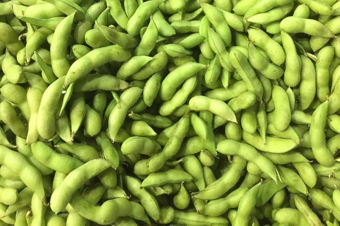Pile of green soybeans, also called edamame beans.