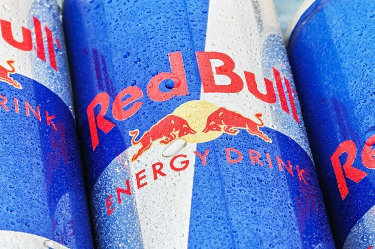 Moscow, Russia - FEBRUARY 27, 2014: Red Bull is an energy drink sold by Austrian company Red Bull GmbH, created in 1987. The most popular energy drink in the world.