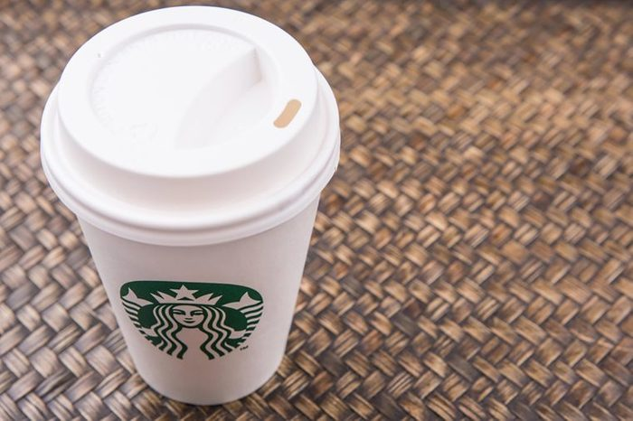 Starbucks coffee to-go cup over wicker background