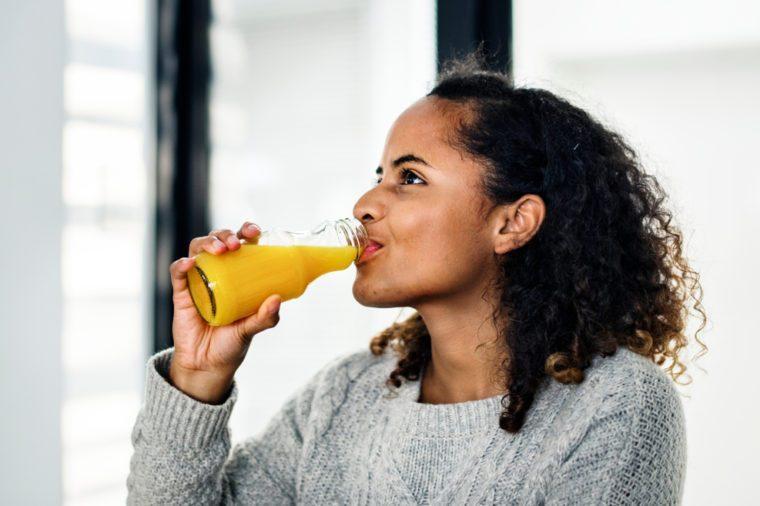 Woman drinking fresh orange juice