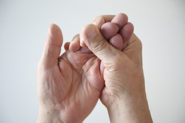Man trying to restore feeling in his numb hands.