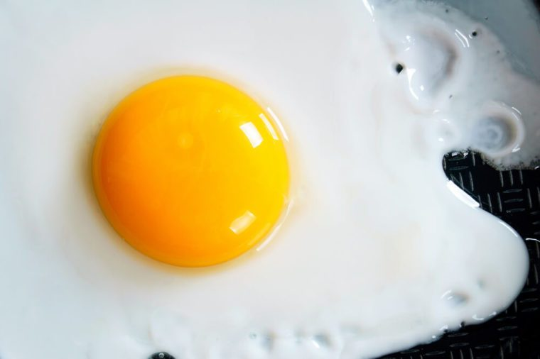 Fried egg on a frying pan. A close up.