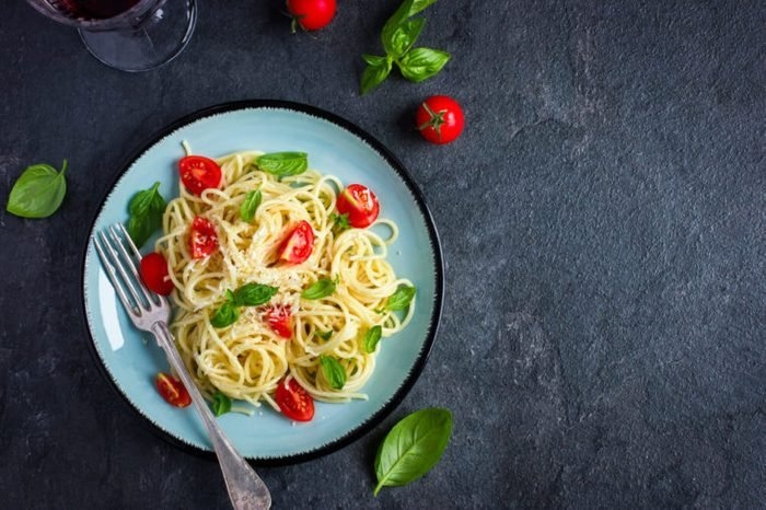 Spaghetti pasta with cherry tomatoes, basil and parmesan cheese