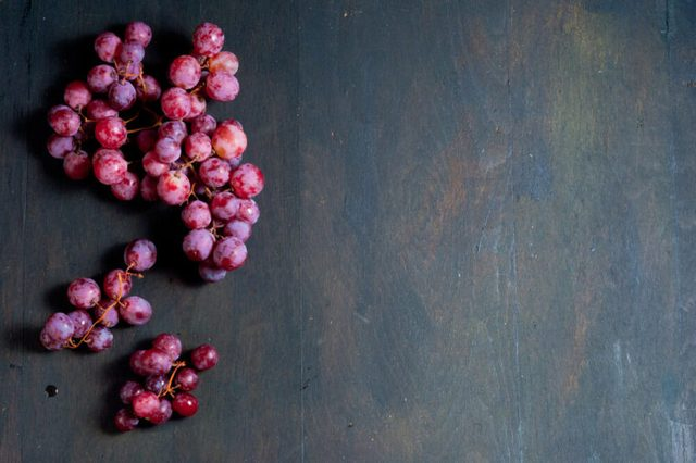 red grapes on old wood table background
