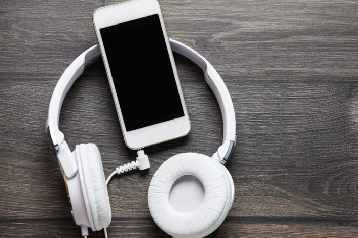 White headphones and smart phone