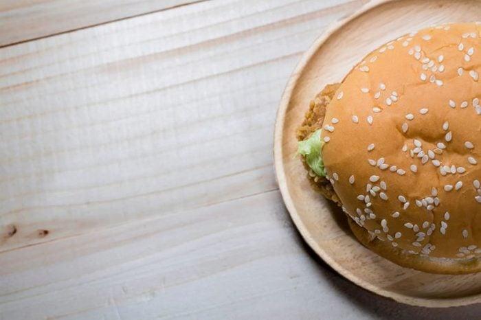 Chicken sandwich on a sesame seed bun