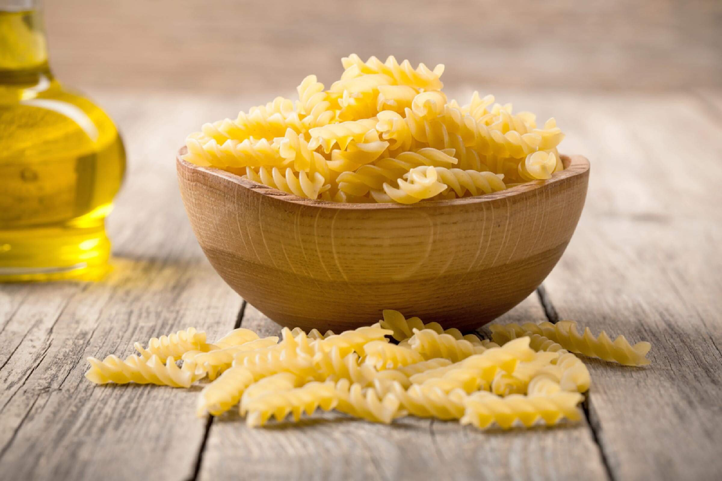 Italian pasta in wooden bowl