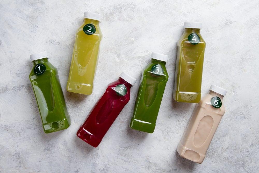 plastic bottles of detox juices