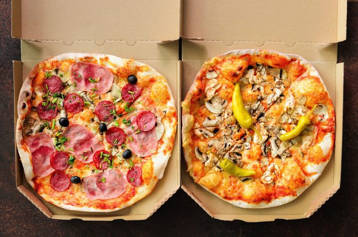 pizzas in delivery boxes