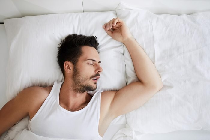 man sleeping on his back, mouth open
