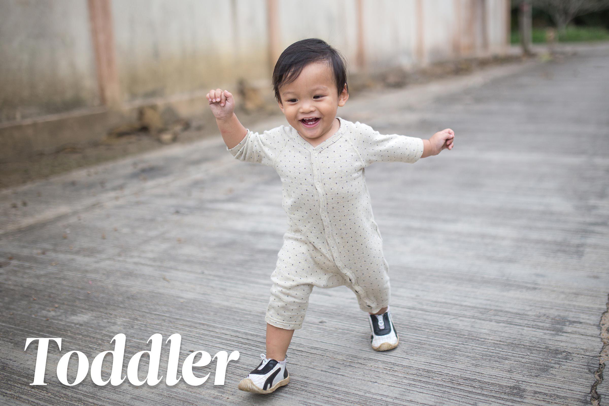 happy toddler running