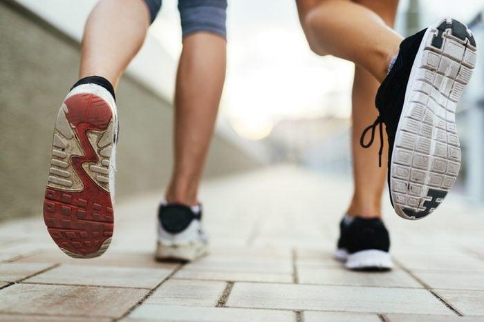 people jogging sneakers