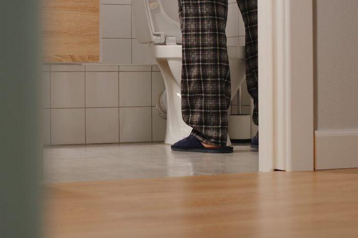 man peeing at night