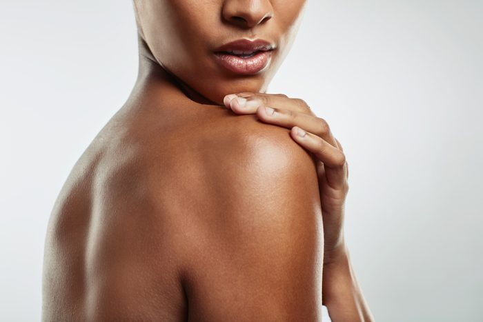 close up cropped shot of woman's shoulder