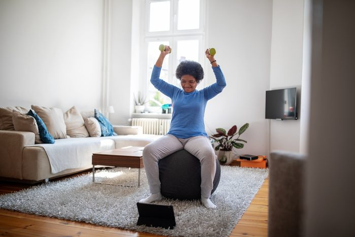 woman doing an online workout at home
