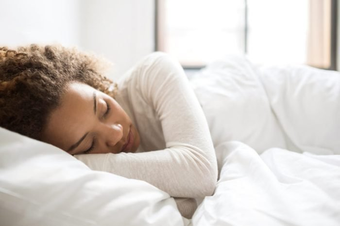 woman sleeping in bed morning