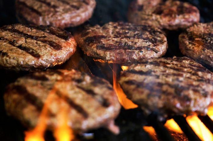 close up of burger patties on the grill