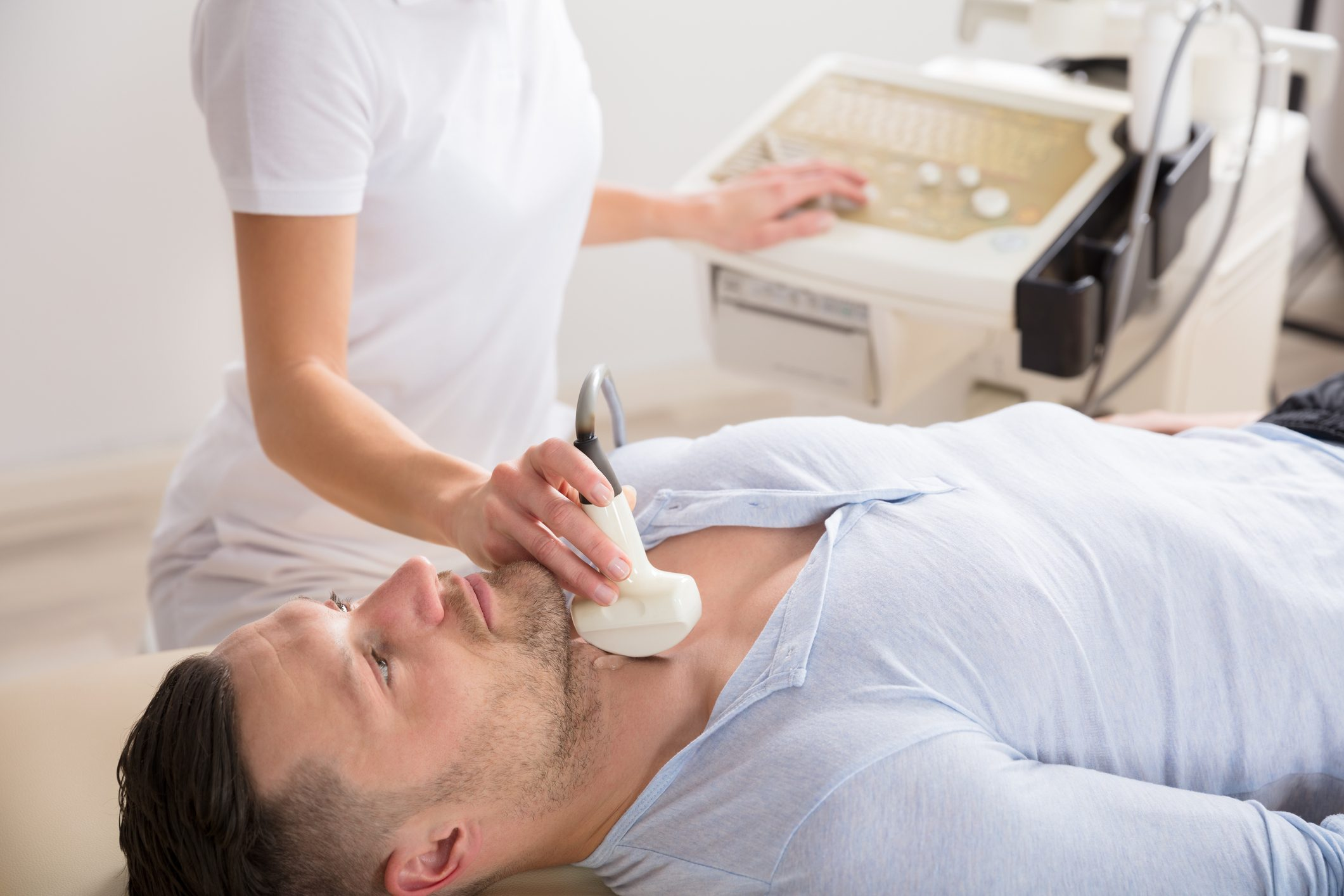 man getting a thyroid ultrasound