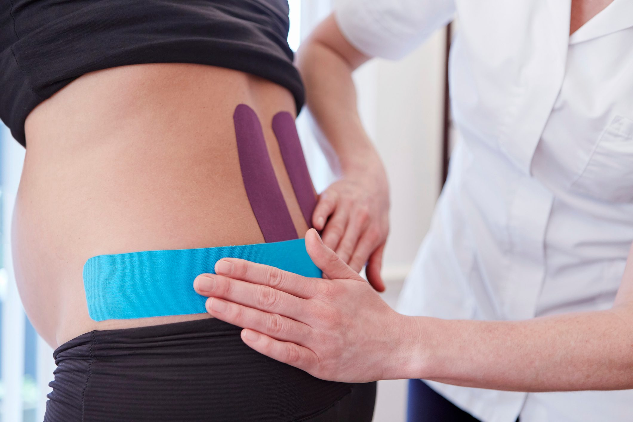 pregnant woman at chiropractor