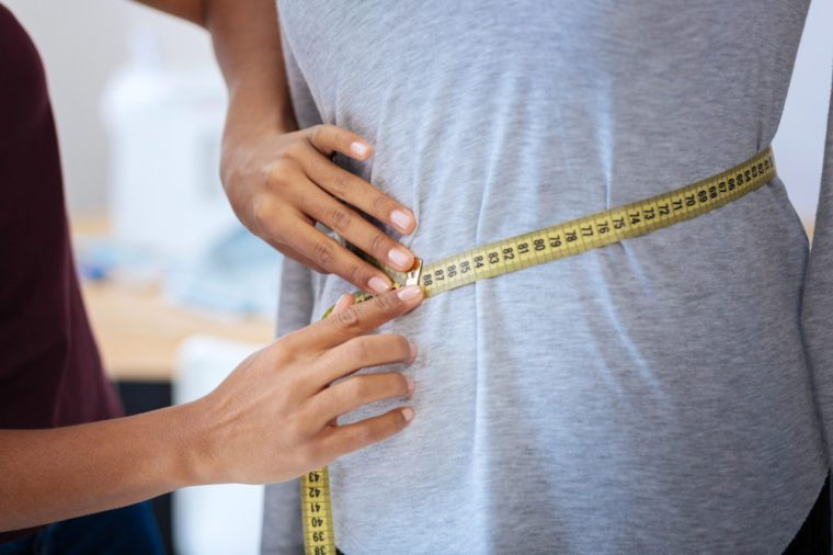 Measuring waist with a tape measure
