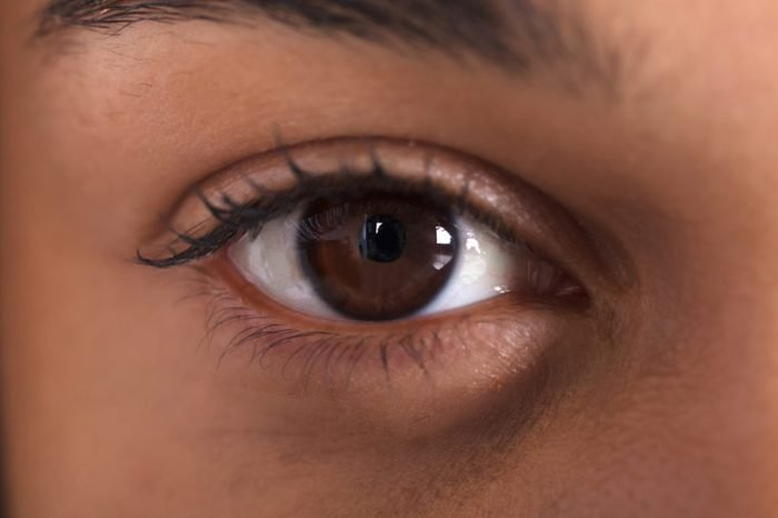 Close-up image of a dark brown eye.