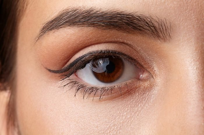 Woman with a brown eye wearing eyeliner and mascara.