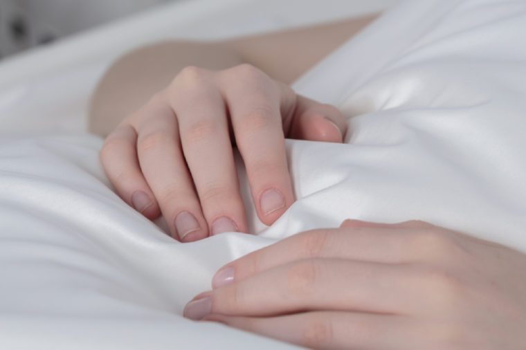 Close-up of sick girl's hands with peripheral venous line