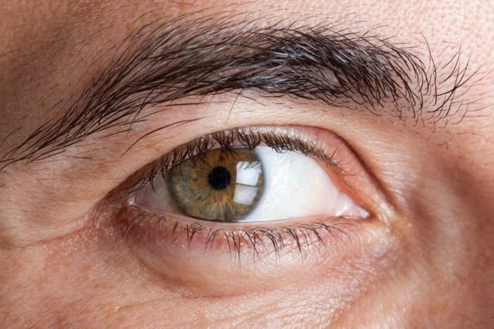 Closeup image of a man's green eye