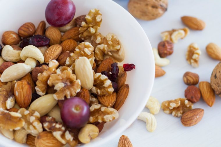 mixed nuts and grapes in a bowl