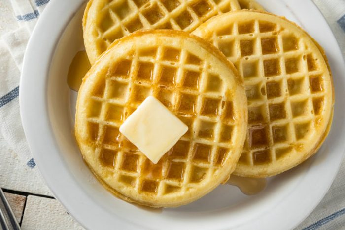 Brown Hot Freezer Waffles with Butter and Maple Syrup