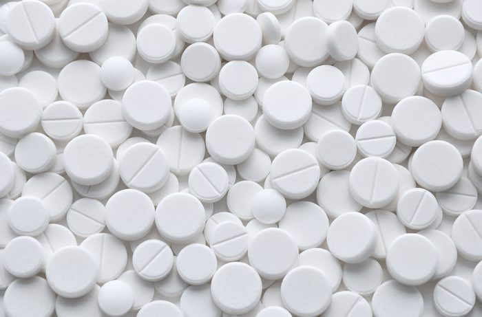 White pills (tablets) background. Medicine objects.