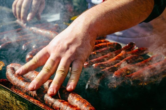 hand on grill meat