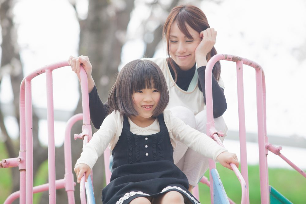 mom and child playing on playground