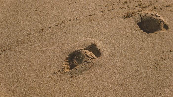 footprint in the beach sand