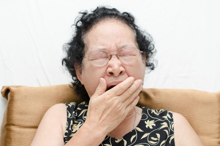 Portrait of emotion asian senior woman with yawn expression