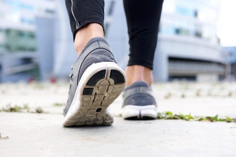 Low angle rear sport shoes walking outside