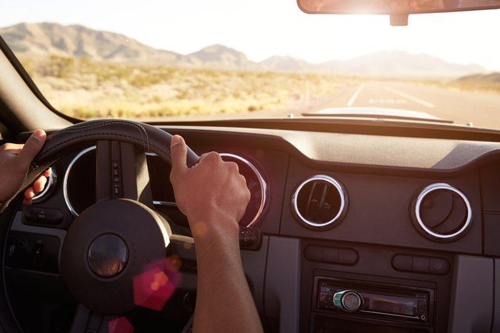 driver's hands on steering wheel