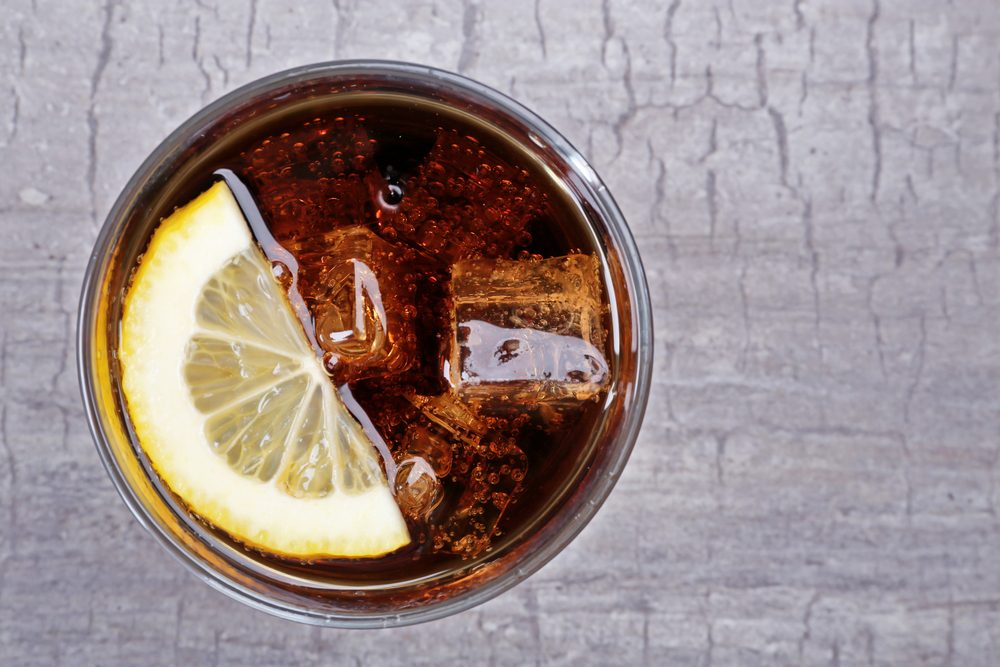 Glass of cola with ice and lemon